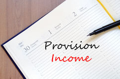 Provision income write on notebook. Provision income text concept write on notebook royalty free stock photo