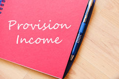 Provision income write on notebook. Provision income text concept write on notebook stock photography