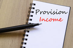 Provision income write on notebook. Provision income text concept write on notebook stock photo