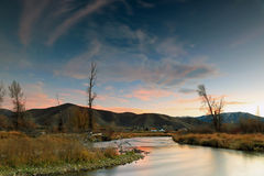 Provo River sunset landscape with farm houses. Autumn sunset with the provo river in Heber Valley, Utah, USA Stock Photography