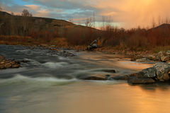 Provo River with sunset sky. Autumn sunset with the provo river in Heber Valley, Utah, USA Stock Photography