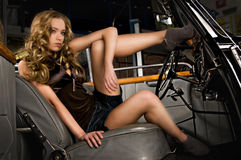 Provocation. Attractive young woman in an old car Royalty Free Stock Image