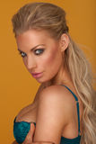 Provocative blond young woman wearing blue bra Royalty Free Stock Photography