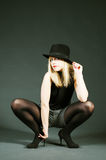 Provocative Blonde Woman With Hat Royalty Free Stock Photography