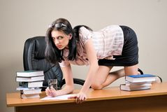 provocative businesswoman on table in office royalty free stock images