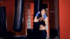 Provocative female Fighter teases, calls for the fight. stock footage
