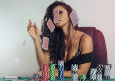 Provocative girl  throwing cards in air Stock Image