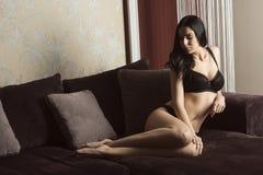Provocative woman posing on sofa Royalty Free Stock Photo