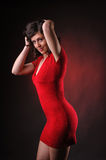 Provocative woman in red dress Stock Photo