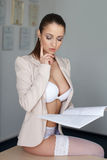 Provocative young businesswoman Stock Photo