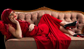 Provocative young girl on sofa Royalty Free Stock Photos