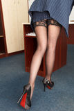 Provocative young secretary with long legs Royalty Free Stock Photo