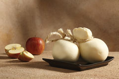 Provola fresca. A typical italian cheese whit apple on background royalty free stock photo