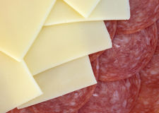 Provolone cheese slices and genoa salami Stock Images