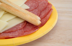 Provolone cheese slices and genoa salami plus breadsticks Stock Image