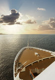Prow of a Cruise Ship Sails into the Sunset Royalty Free Stock Images