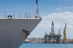 Prow of gray Battleship frigate docked in the grand harbor. Battleship gray prow of Doorman-class frigate F831 docked in the shipyards of the Grand Harbor of Stock Photography