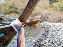 Prow of local traditional long tail boat tied with fabric three colors Stock Photo