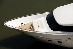 Prow of luxurious white yacht. Overhead view of luxurious white yacht prow on river Royalty Free Stock Photo