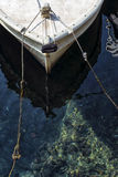 Prow of a traditional mediterranean fishing boat. Tied with ropes in the port Stock Photo