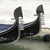 Prow of two Venetian gondolas Stock Images