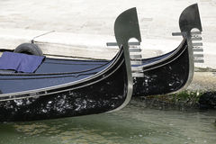 Prow of two Venetian gondolas Royalty Free Stock Image