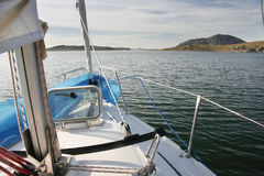 Prow view of sailboat sailing across Alange Reservoir, Spain Stock Image