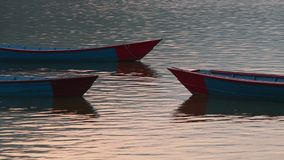 Prows of moored boats. At sunrise stock footage