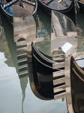Prows of two gondolas Royalty Free Stock Image