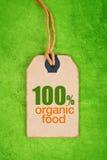 100 Prozent des biologischen Lebensmittels auf Preisschild-Tag Lizenzfreie Stockfotografie