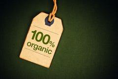 100 Prozent des biologischen Lebensmittels auf Preisschild-Tag Lizenzfreies Stockbild