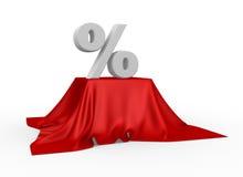 Prozentsatzreduzierungssymbol auf einer Tischdecke Stockbild