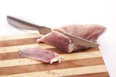 Prozess des Ausschnitts von Schweinefleisch Stockfotos