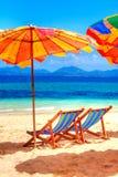 Présidences de paquet à la plage Photos stock