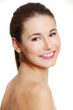 Prtrait of a female teen with naked arms. Back view portrait of a young beautiful female caucasian teen having naked arms, smiling to the camera, on white Royalty Free Stock Photo