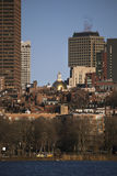 Prudential Building, State House and Boston Skyline in winter on half frozen Charles River, Massachusetts, USA Stock Image