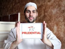 Prudential plc financial services company logo. Logo of Prudential plc on samsung tablet holded by arab muslim man. Prudential plc is a British multinational Stock Photo