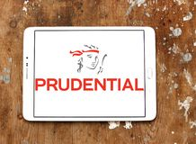 Prudential plc financial services company logo. Logo of Prudential plc on samsung tablet on wooden background. Prudential plc is a British multinational life Royalty Free Stock Images