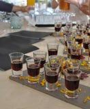 Prueba de la bebida del alcohol en tiros Imagen de archivo libre de regalías