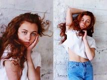 Pruebas modelo Muchacha hermosa del pelirrojo con el pelo rizado Color natural Retrato de Krupneishego en un fondo del ladrillo l Foto de archivo
