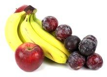 Prugne delle mele delle banane su un fondo bianco Fotografia Stock Libera da Diritti