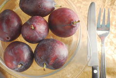 Prune. Plum fruit on a plate Royalty Free Stock Photos