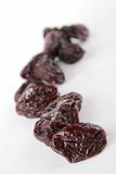 prune. On white background Stock Photo