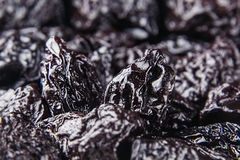 Prune close up background. Heap of glossy black prunes. Top view royalty free stock photography