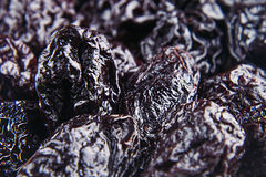 Prune close up background. Heap of glossy black prunes. Top view royalty free stock photos