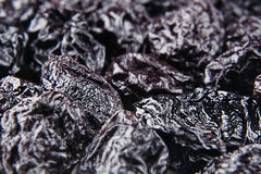 Prune close up background. Heap of glossy black prunes. Top view stock images