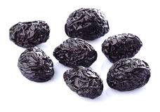 Prune in closeup. Prune on a white background Stock Image