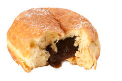 Prune filled Paczek. One polish doughnut or Paczek with the prune filling spilling out Stock Image