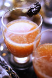 Prune and grapefruit juice. On table Royalty Free Stock Images