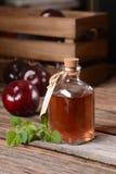 Prune juice in small bottle Stock Photo